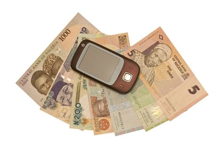 The pocket computer lying on a fan from Nigerian money