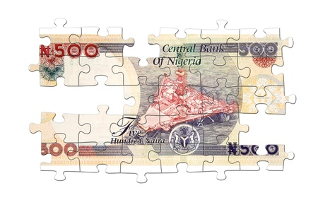 Five hundred naira banknote puzzled on wight photo