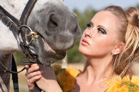 Horse and butiful woman face to face photo