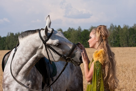 Horse and butiful woman face to face