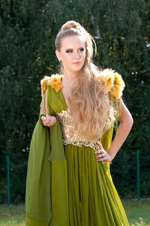 the woman in a beautiful old style green dress photo