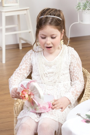 Girl looking in to gift box in white studio Stock Photo - 13050447