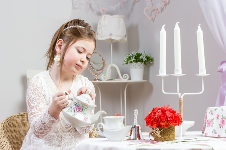 A beautiful little girl having a tea party Stock Photo - 13050454