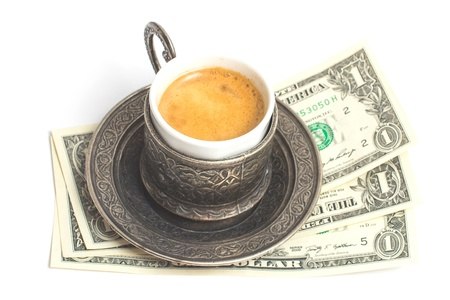 Ð¡up of coffee with 3 dollars tip on white background. photo