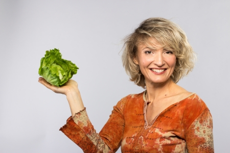 Beautiful woman with green cabbage, isolated on white Banque d'images