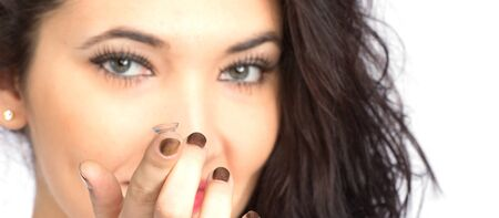 contact lense: Young woman with contact lense focused on lens Stock Photo