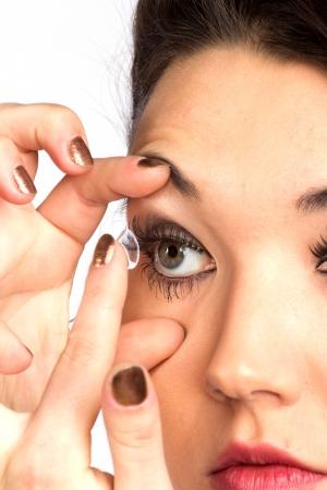 contact lense: Young woman with contact lense Stock Photo
