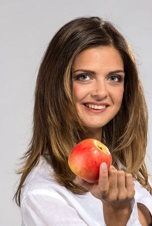 Woman with apple in man`s shirt photo