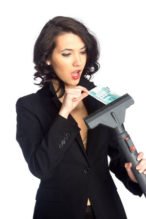 Business woman pull money from vacuum cleaner, isolated on white Stock Photo - 17604576