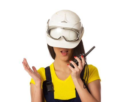 The girl in a helmet lowered on eyes, isolated on white Stock Photo - 18056951