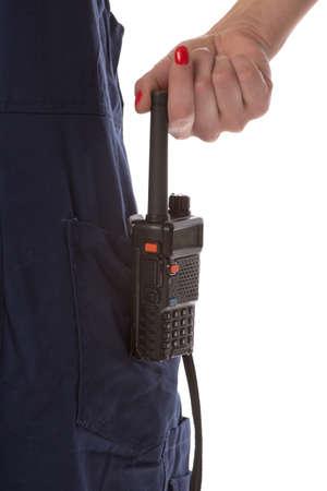 cb: Woman hand take off cb radio from pocket