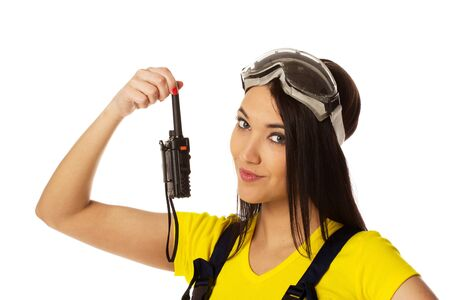 Woman hold cb radio. Isolated on White photo