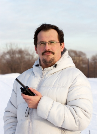 cb: Man with cb radio outdoors winter day  Stock Photo