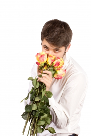 suprise: man with bouquet of red roses. Isolated on white. Stock Photo