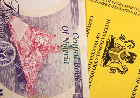 diphtheria: Nigerian vaccination book on nairas banknotes