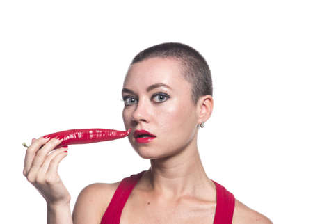 Woman with chili pepper on white background photo