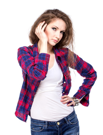 Attractive young woman in a checkered shirt, isolated Stock Photo