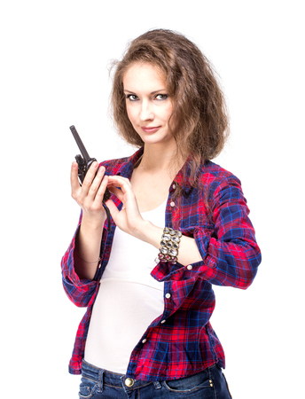 walkie talkie: Attractive young woman in a checkered shirt with walkie talkie, isolated