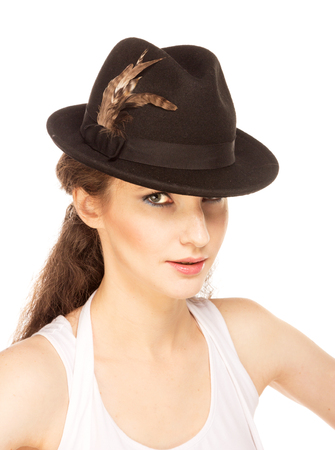 Pretty woman in hat with birds feather, isolated photo
