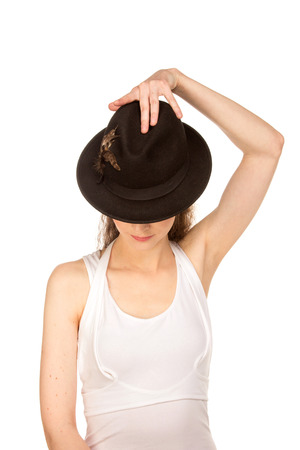 fair complexion: Stranger woman in hat with hidden eyes, isolated on white