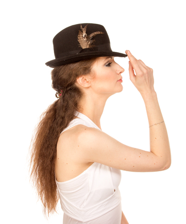 fair complexion: Pretty woman in hat with birds feather, isolated Stock Photo