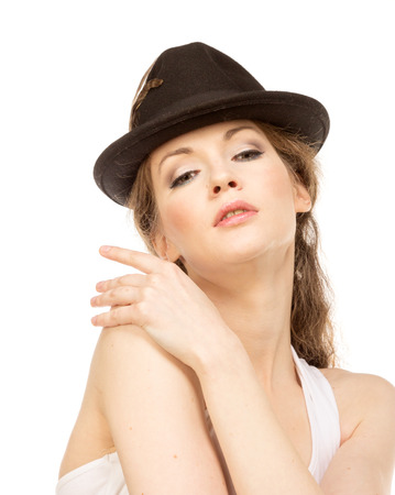 hat with feather: Pretty woman in hat with birds feather, isolated Stock Photo