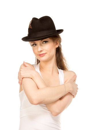 Pretty woman in hat with birds feather, isolated Stock Photo