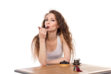 Charming woman in a restaurant, isolated photo