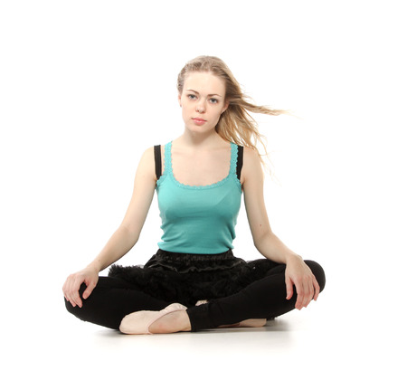 Young woman in advanced sitting yoga pose, isolated on white background photo