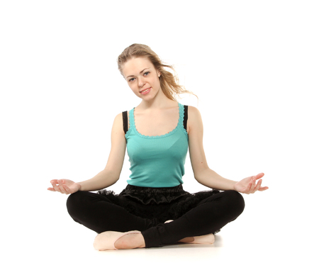 kundalini: Young woman in advanced sitting yoga pose, isolated on white background