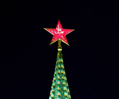 broach: Red star of Moscow Kremlin, Russia, night time Stock Photo