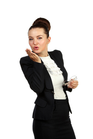 Business woman with glass in hand send a kiss, isolated photo