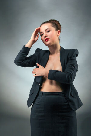 Beautiful woman nude back on dark background photo