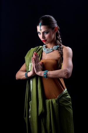 Beautiful Indian girl dancing in national dress Stock Photo