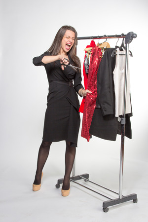 hysterics: woman in hysterics going to cut red dress