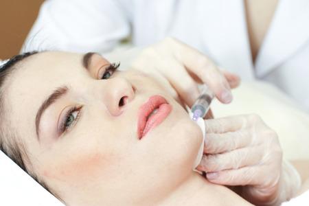 Woman Having Botox Treatment At Beauty Clinic, close up. Focus on syringe
