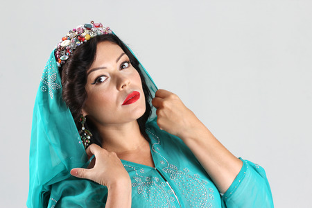 yashmak: Adult woman in green arabian abaya Stock Photo