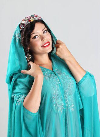 yashmak: Adult arabian woman in green abaya