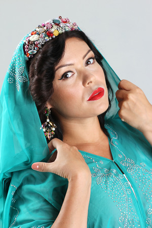 paranja: Adult arabian woman in green abaya
