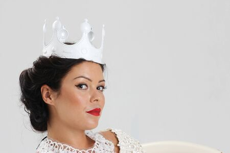 tanned woman: Portrait of happy tanned woman in crown Stock Photo