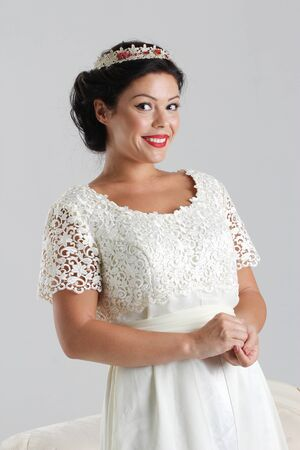 Beautiful woman in white crown, holliwood style