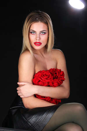 Beautiful blond woman with naked back and flowers photo