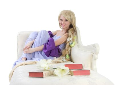 rapunzel: Long hair princess posing on sofa with books