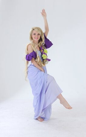 rapunzel: Long hair princess posing in studio Stock Photo