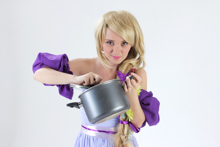 rapunzel: Blond princess with pan on studio