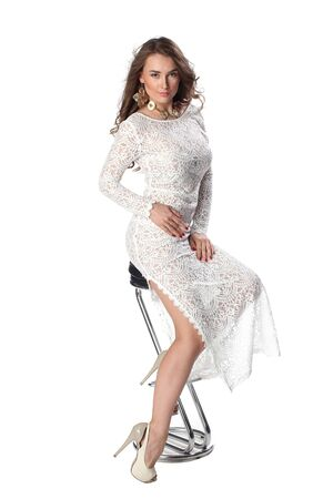 classy: Attractive young woman in classy white dress over white background