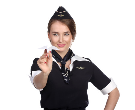 airline hostess: JUN 31, 2015 Air hostess in new uniform of national Russian airline Aeroflot, skyteam member. Holding Paper Plane In Hand.