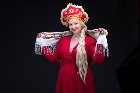 kokoshnik: Girl standing in Russian traditional costume. Woman is wearing sarafan and kokoshnik. The girl in red old russian dress. Isolated on black.