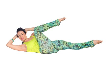 corpse: Young woman practicing yoga, lying on back with feet up, Corpse Pose variation, isolated on white Stock Photo
