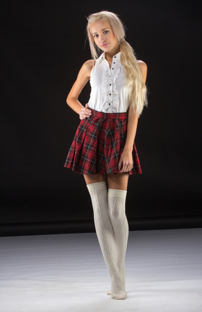 short skirt: Lovely sexy blonde girl in checkered short skirt, isolated on white